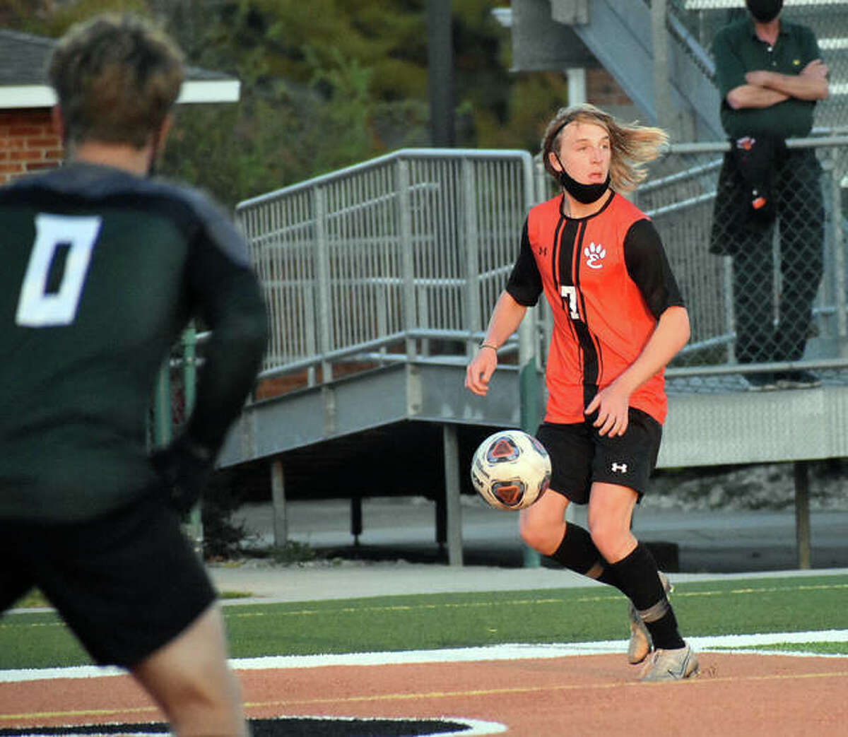 Edwardsville's Ben Loftus streaks down the side of the field and looks for a teammate to cross a pass to during the first half. O'Fallon keeper Ben Eckell is in the foreground.