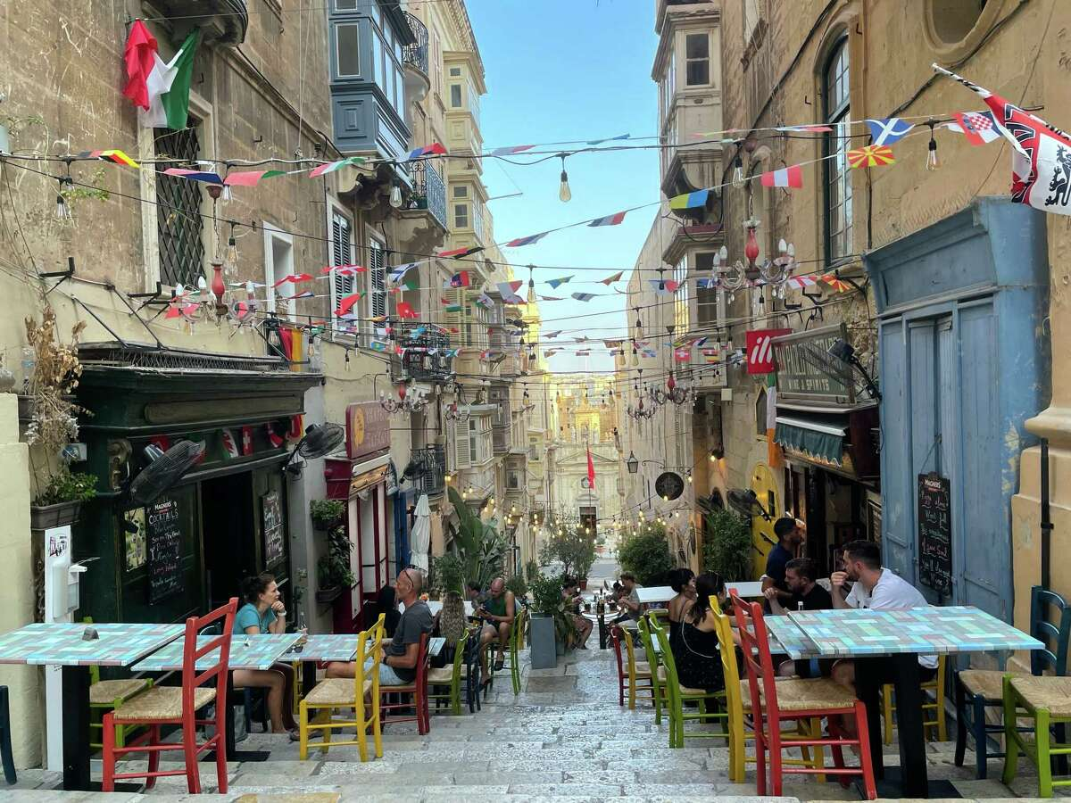 In Valletta, the capital of Malta, restaurants set up tables along the narrow side streets. Only Americans who have received a coronavirus vaccine are permitted to enter the Mediterranean island nation.