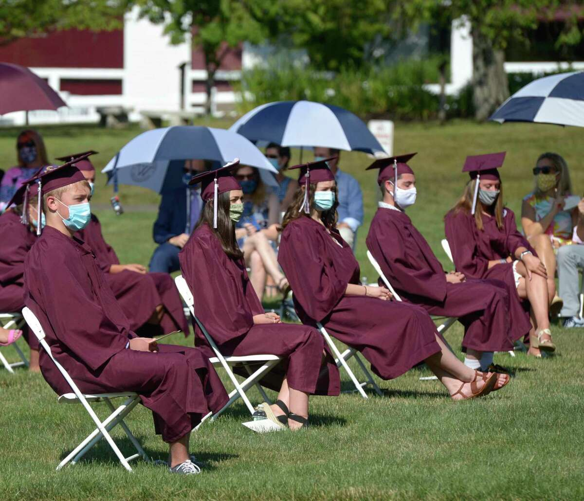 Photographs from the Wooster School 2020 Commencement Exercises, Monday, July 6, 2020, on the school campus, Danbury, Conn. The school will require vaccines for staff and eligible students as part of its 2021-22 return-to-school plan.