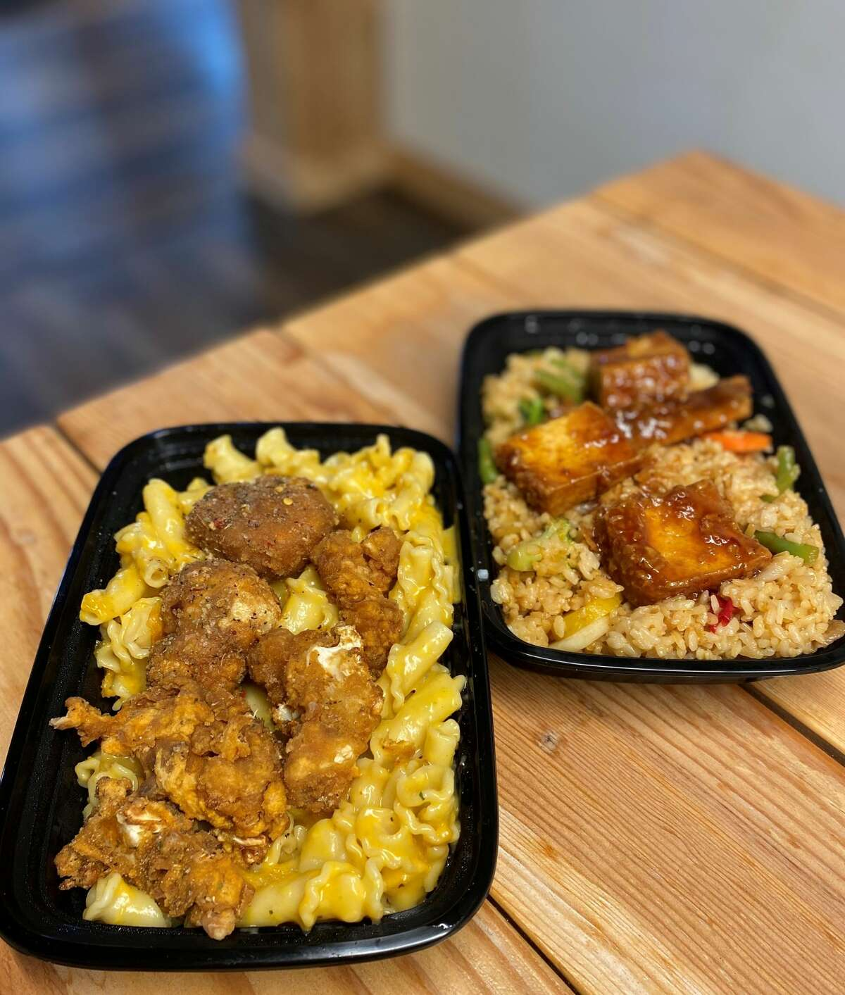 Mac and cheez with fried cauliflower, left, and vegetable fried rice with General Tso's tofu.