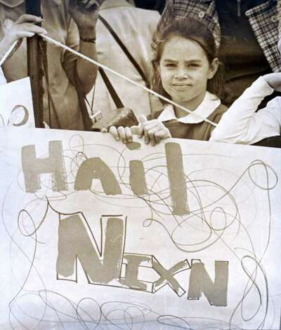 "1970: Jackie Walsh holds a ""Hail Nixn"" sign during President Richard Nixon's visit to the Italian Center of Stamford. Photo: File Photo / Stamford Advocate File Photo"