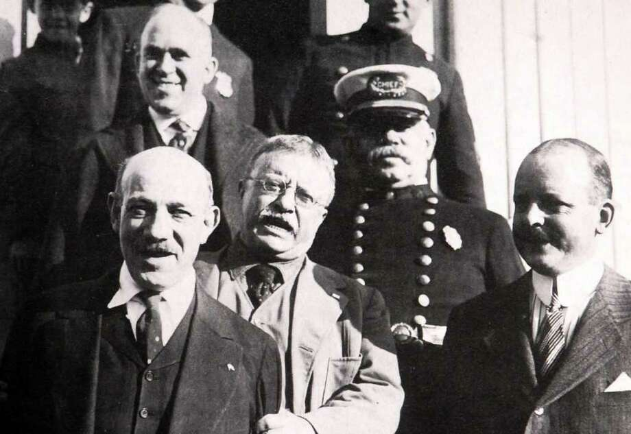 1917: Former President Teddy Roosevelt, center visited Jack Copper's Health Farm on Hgh Ridge Road to reduce his waistline.  He is pictured here with Chief of Police William Brennan. Photo: File Photo / Stamford Advocate File Photo