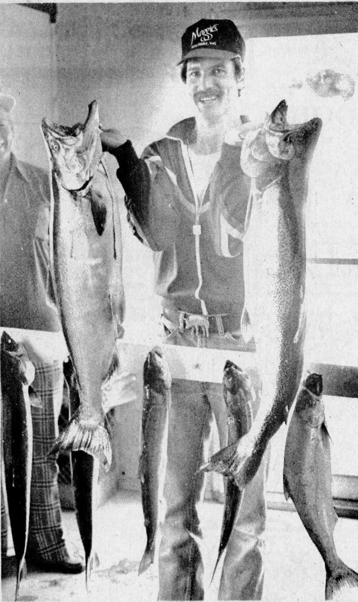 An All-Star pitcher lands an All-Star catch. Jack Morris, ace right-hander for the Detroit Tigers and the starting pitcher for the American League in the All-Star game this year, proudly holds two king Salmon he caught fishing off Manistee's port yesterday afternoon. The photo was published in the News Advocate Aug. 21, 1981.(Manistee County Historical Museum photo)
