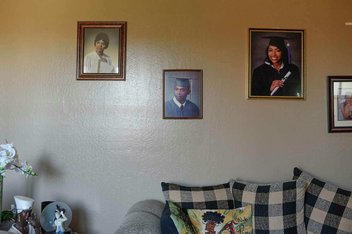 A photograph of a home with pictures of a family.