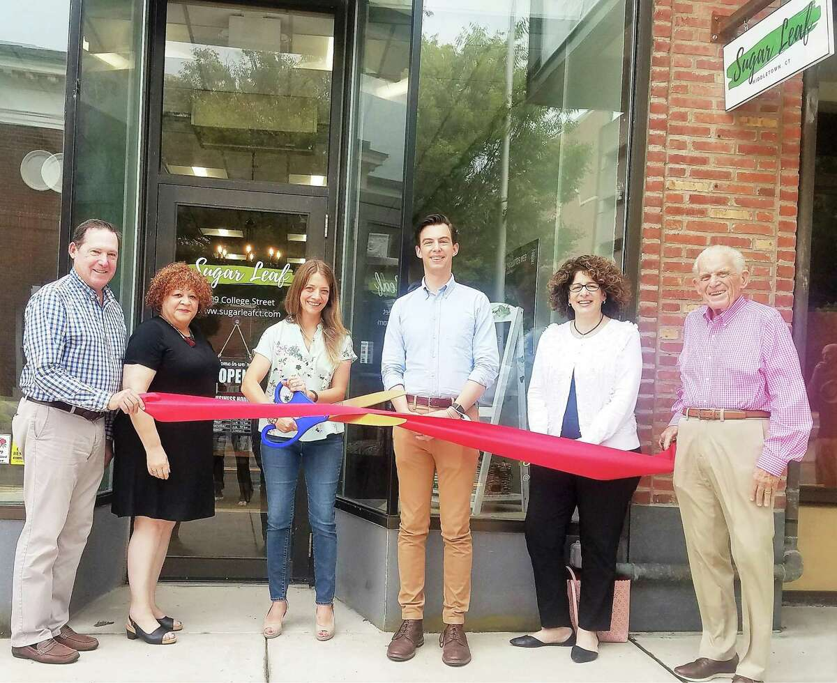 Sugar Leaf of Middletown celebrated its grand opening Aug. 5. From left are Hajjar Management Managing Director Tom Ford, Middlesex County Chamber of Commerce Central Business Bureau Chairwoman Pamela Steele, owner Kristin Souza, Mayor Ben Florsheim, Downtown Business District Coordinator Sandra Russo-Driska, and chamber President Larry McHugh.