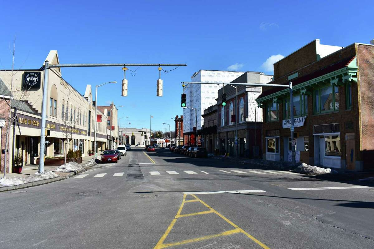 Wall Street on Feb. 15, 2017 in downtown Norwalk, Conn., with the planned Wall Street Theater on the right. Area businesses hope the theater will provide a boost to the area that was stunted by the stalled construction of the POKO Place apartments a few doors down, right.