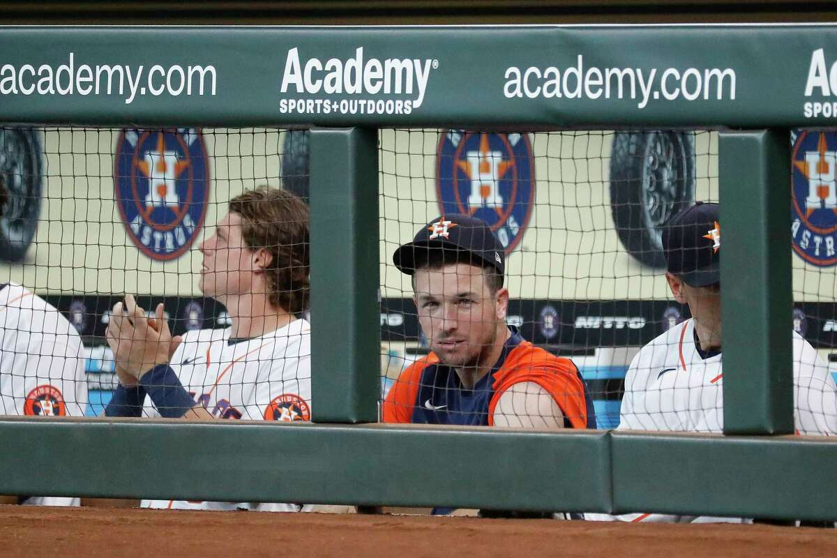 Houston Astros Alex Bregman cheers for Michael Brantley in the dugout after his single during the first inning at Minute Maid Park, Wednesday, August 11, 2021, in Houston.