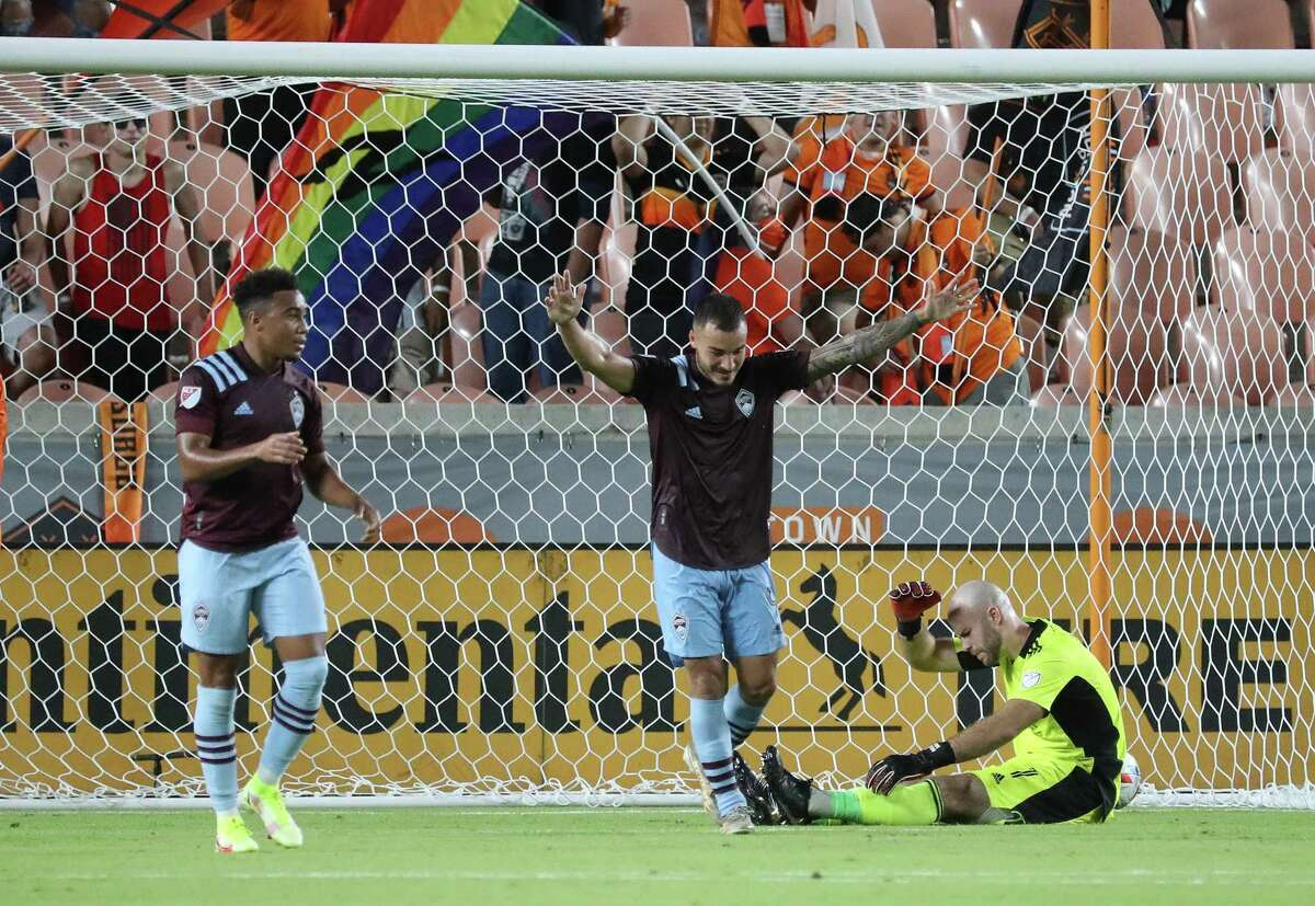 The Dynamo had breakdowns early and late in their loss to Colorado on Aug. 14. Rapids forward Andre Shinyashiki celebrates a goal against Houston goalkeeper Marko Maric during the second half.