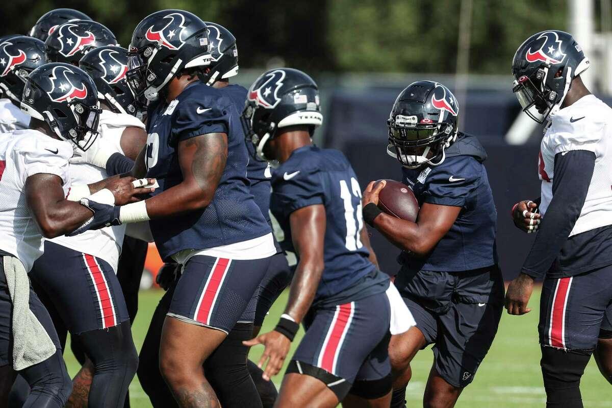 Houston Texans running back Mark Ingram II (2) runs the ball during an NFL training camp football practice Thursday, Aug. 19, 2021, in Houston.