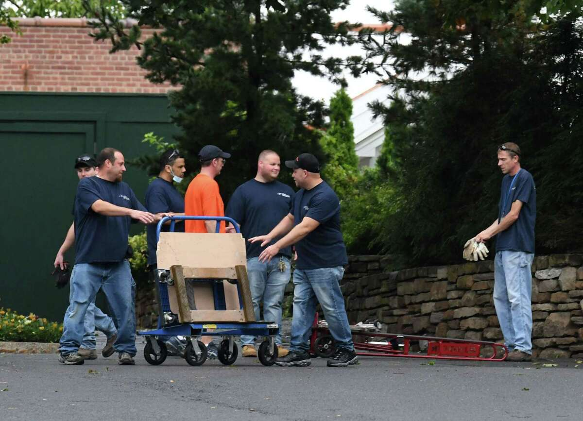 A moving crew from the New York State Office of General Services moves Gov. Andrew Cuomo?•s belongings from the Executive Mansion on Friday, Aug. 20, 2021, Albany, N.Y. The governor's resignation is expected to go into effect at 11:59 p.m. Monday.