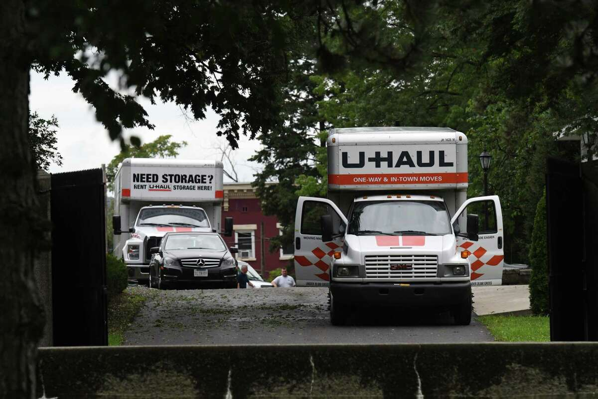 Moving trucks prepare to leave the Executive Mansion after workers from the New York State Office of General Services packed Gov. Andrew Cuomo?•s belongings on Friday, Aug. 20, 2021, Albany, N.Y. The governor's resignation is expected to go into effect at 11:59 p.m. Monday.