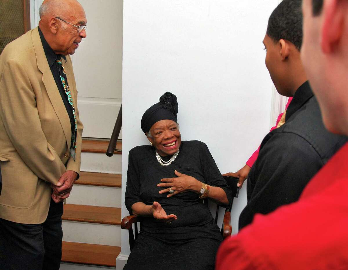 Award-winning poet, civil rights activist and playwright, Maya Angelou, center, speaks with Union College Professor Emeritus Twitty Styles, left, and college students prior to speaking to an overflow crowd at Union College's Memorial Chapel on October 22, 2007.