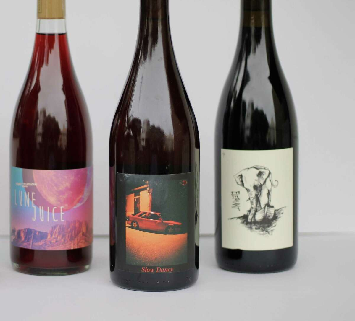 A selection of zero-zero California wines, from left: Subject to Change Lune Juice (Zinfandel); Slow Dance Pet-Nat Rose (Cabernet Sauvignon); and Absentee Elephant Red (Syrah).