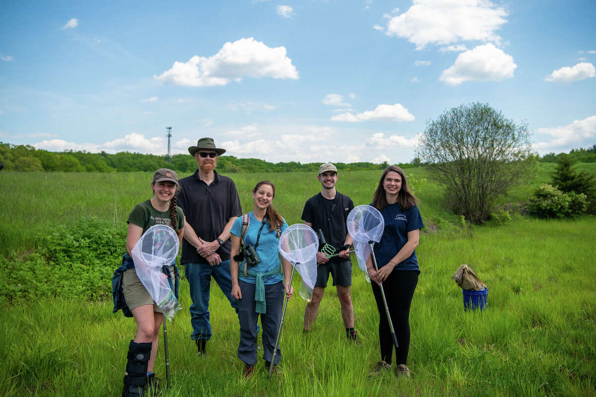 Researchers at SUNY New Paltz are exploring how to create a habitat for wildlife that is compatible with solar energy production. From left: student Kristyn Gessner '21; associate professor Aaron Haselton; associate professor Kara Belinsky; student Dan Hughes '22; and student Megan Sisti '21.
