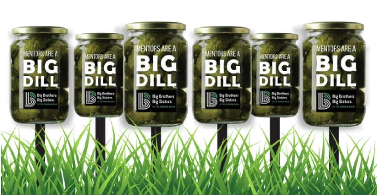 Have you noticed the dill pickle signs popping up around town?