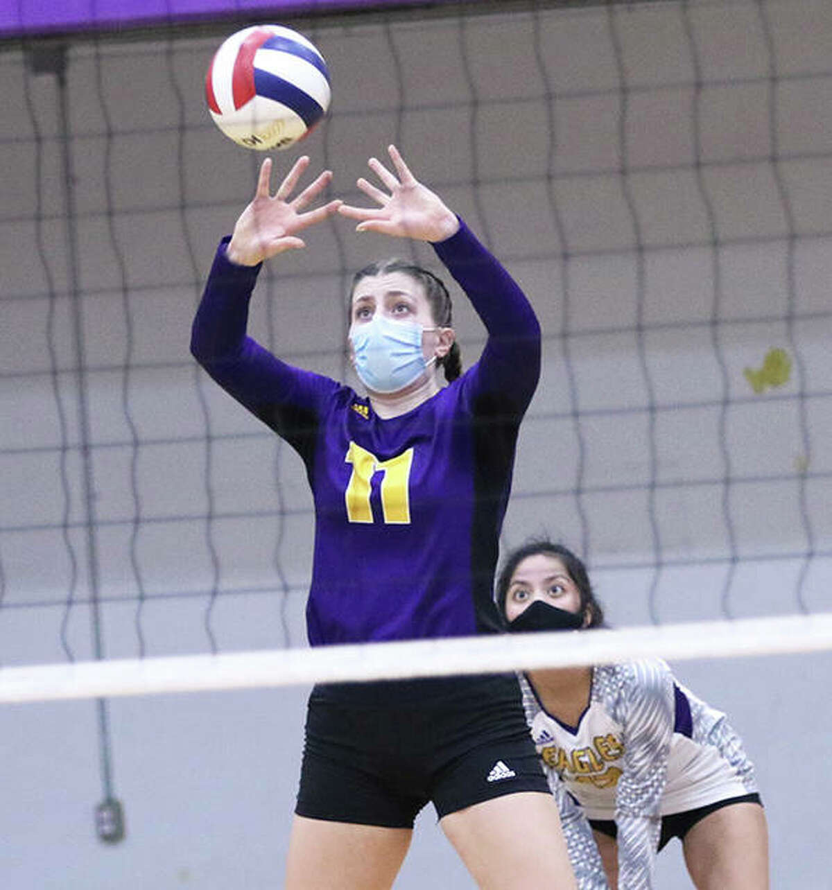 Jackie Woelfel was a standout in volleyball, basketball and track at Civic Memorial. She will learn a fourth sport, rowing, beginning Monday at Kansas.