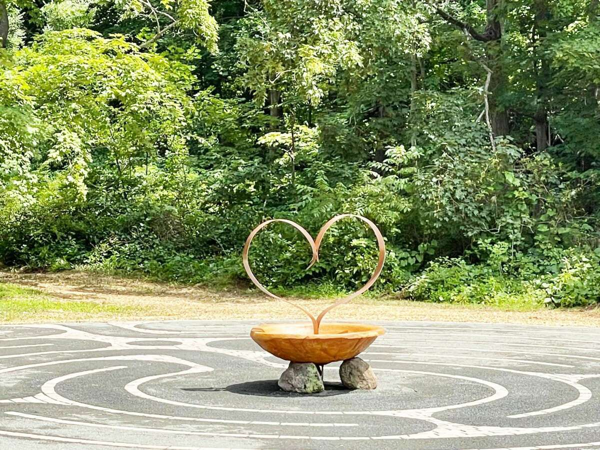 The official unveiling of The Heartstone Labyrinth at the Levi Coe Library in Middlefield will be held Aug. 28. The sculpture, formed into a bowl, is 300 pounds of reinforced concrete with a pulsating, fabricated, kinetic steel-painted heart, according to those involved in the project.