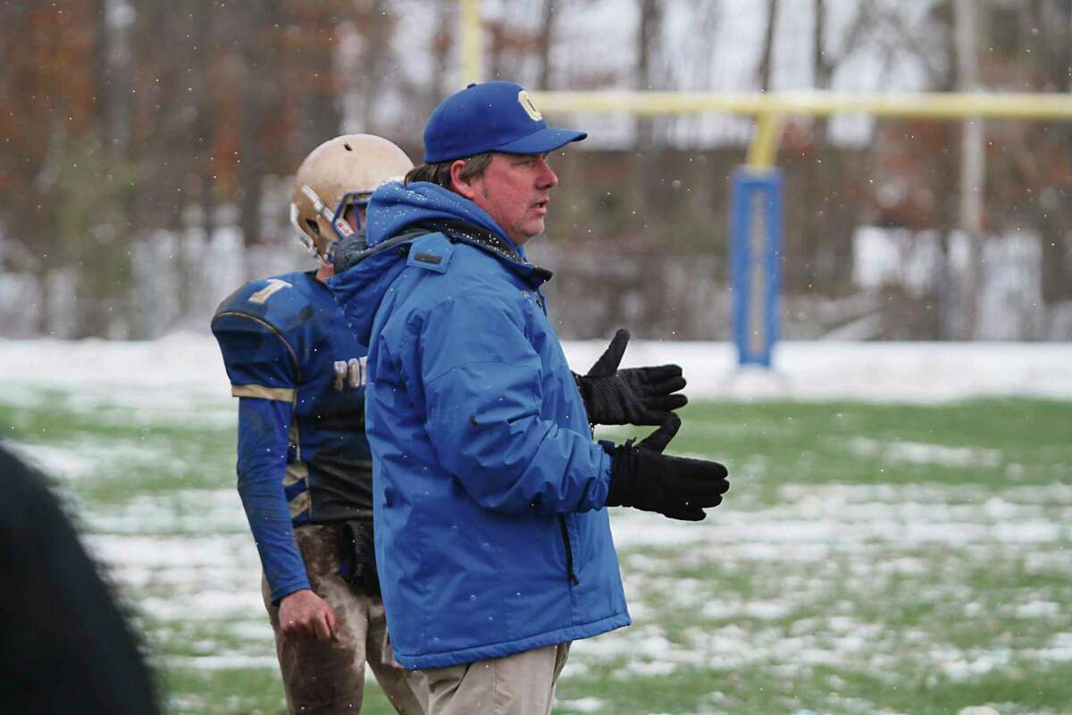 Onekama head football coach John Neph coaches from the sidelines during a game in 2018. (File photo)