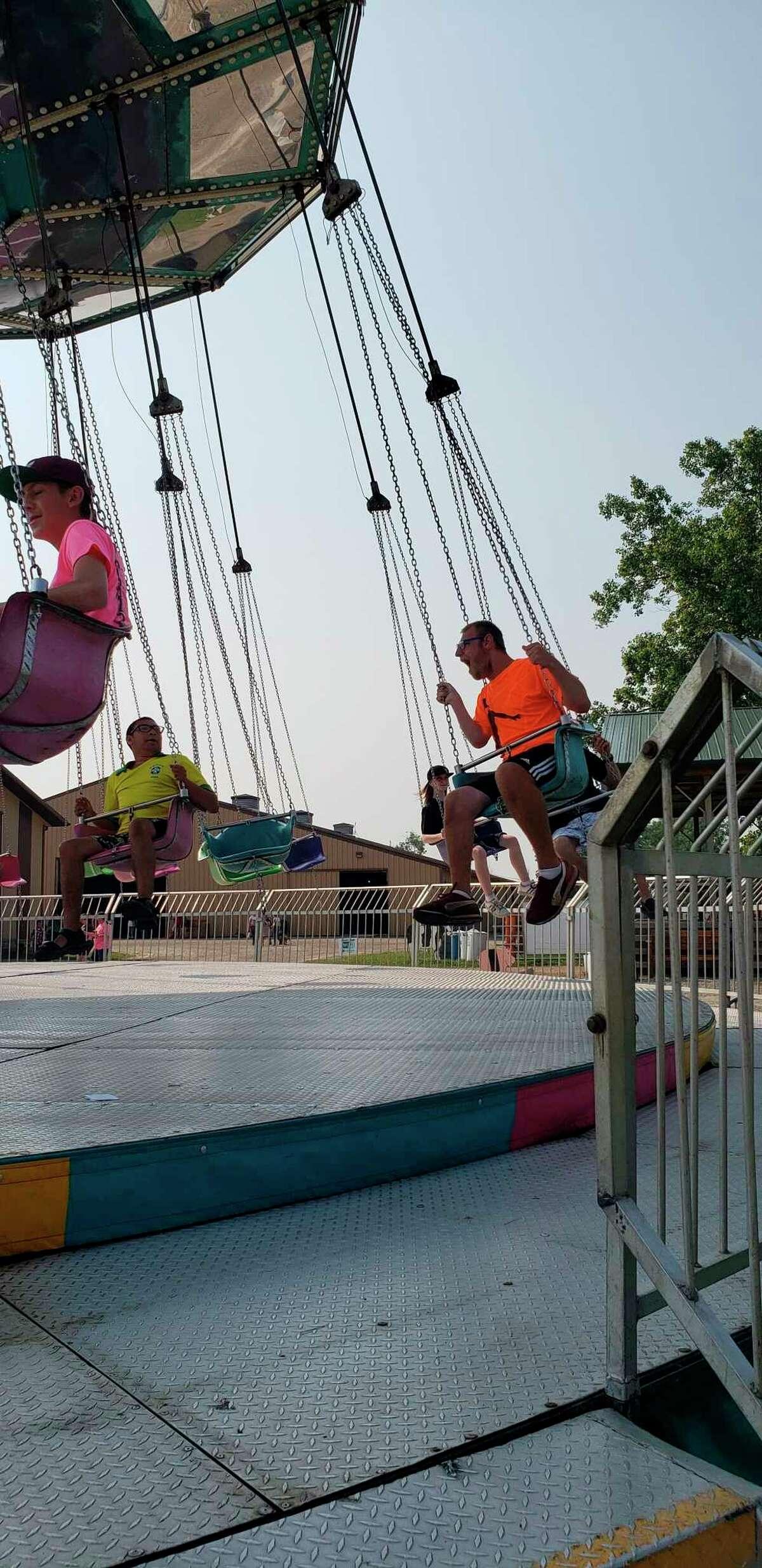 Kids enjoyed riding the swings at the Huron Community Fair. (Courtesy Photo)
