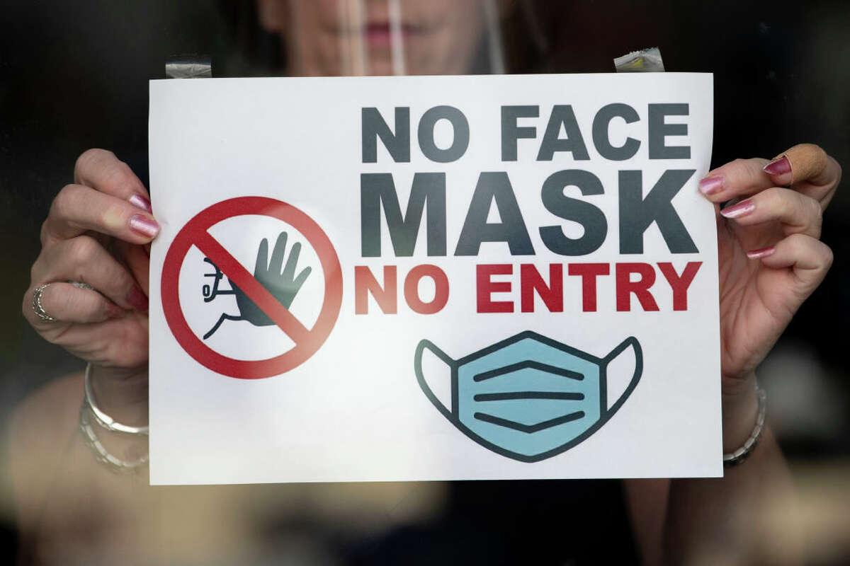 """'No face mask no entry"""" sign at a store."""