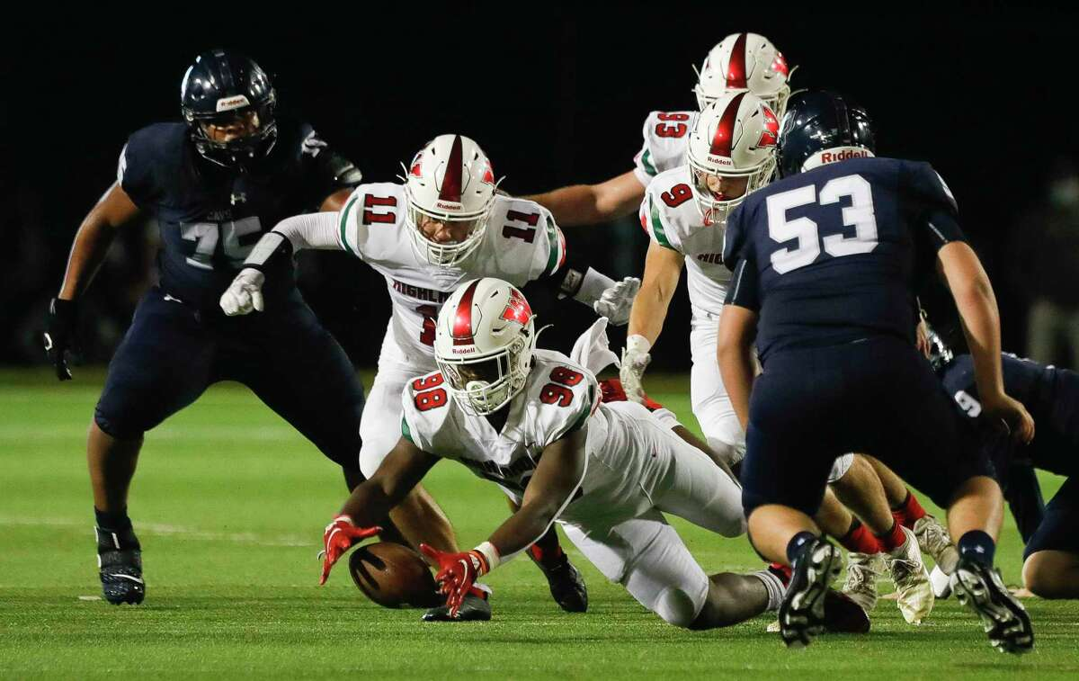 The Woodlands defensive linemen Bradley Warren (98) recovers a fumble by College Park quarterback Hank Hudson during the second quarter of a high school District 13-6A high school football game in Shenandoah.