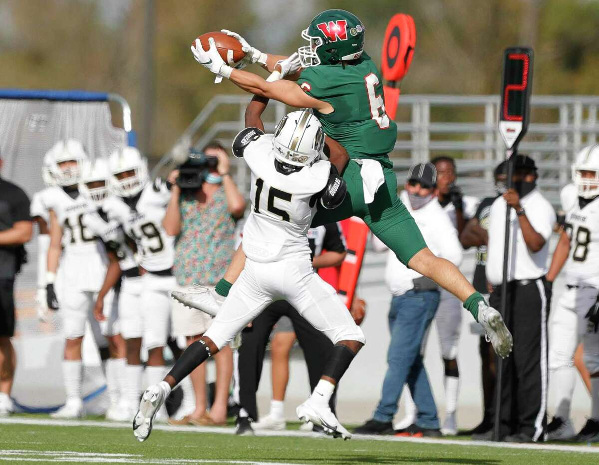 Conroe defensive back Bradin Bradford (15) breaks up a pass intended for The Woodlands wide receiver Ben Ferguson (6) during the first quarter of a District 13-6A high school football game at Woodforest Bank Stadium, Saturday, Nov. 21, 2020, in Shenandoah.