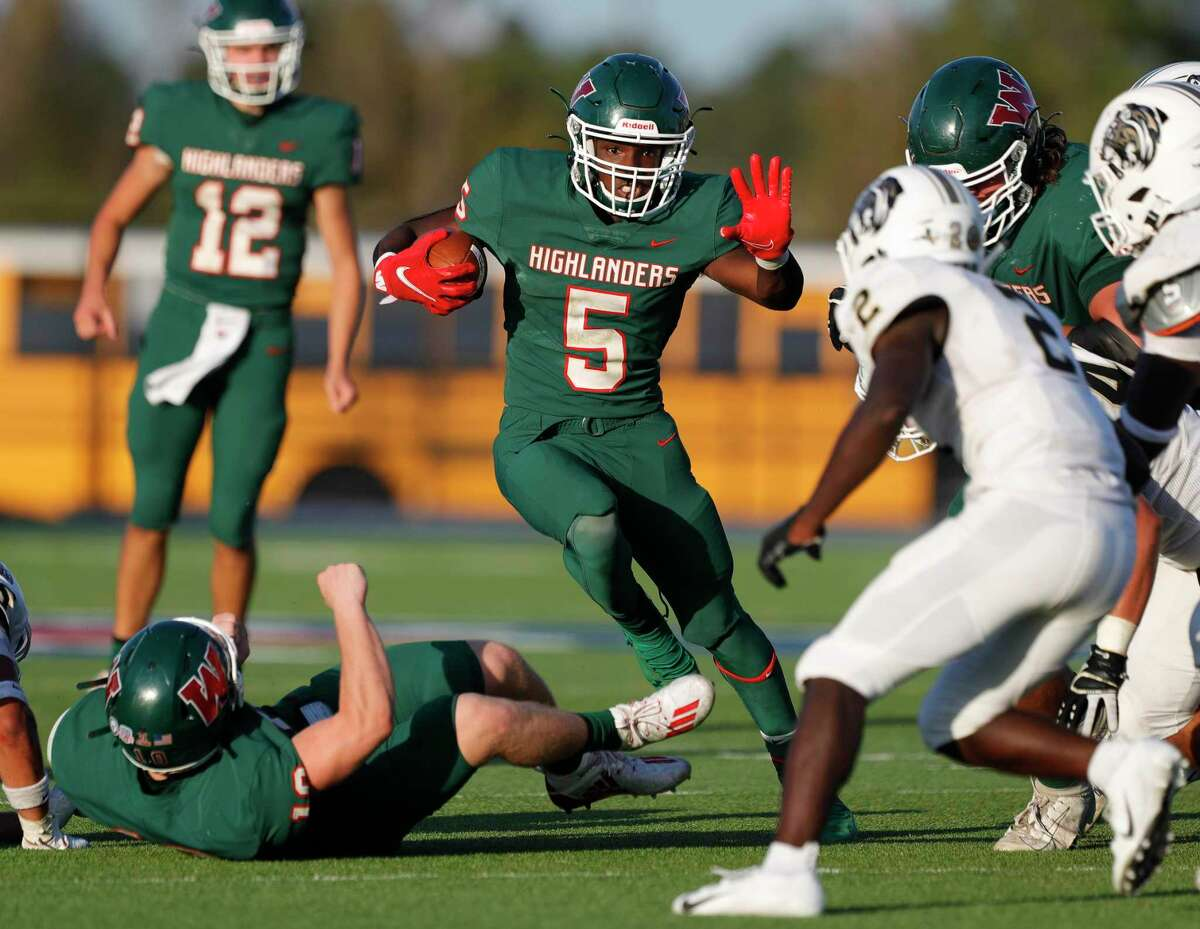 The Woodlands running back Jobarre Reed (5) looks for running room during the fourth quarter of a District 13-6A high school football game at Woodforest Bank Stadium, Saturday, Nov. 21, 2020, in Shenandoah.