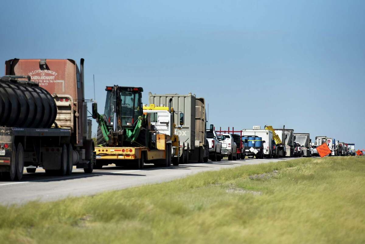 Trucks idle on Highway 302 near Kermit. A reader can't believe Texas Sens. John Cornyn and Ted Cruz voted against the infrastructure bill.