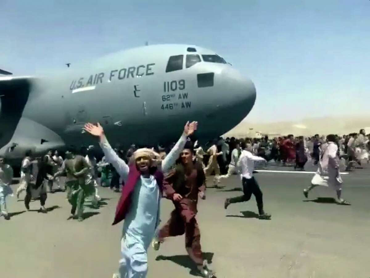 Hundreds of people run alongside a U.S. Air Force C-17 transport plane in Kabul, Afghanistan. Must this failure make the world a more dangerous place?