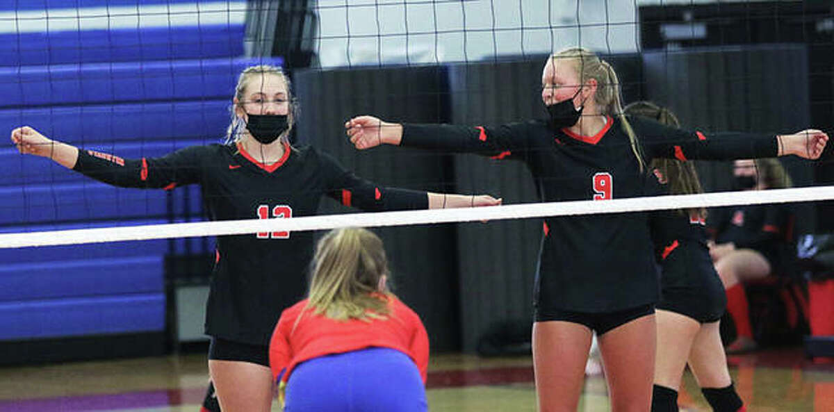 Staunton's Haris Legendre (left) and Danielle Russell (9) wait for serve during a SCC volleyball match at Roxana last season. The Bulldogs, expecting another big season after going 14-2 and winning the SCC, are on hold for the 2021 season with Staunton sports temporarily shut down because of COVID-19 concerns.