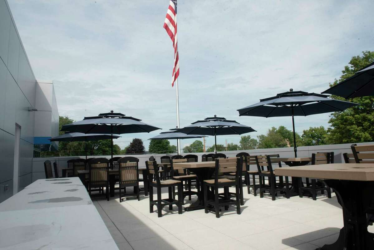 Tables and chairs are set up on a rooftop patio at the new Mohawk Chevrolet on Friday, Aug. 20, 2021 in Ballston Spa, N.Y.