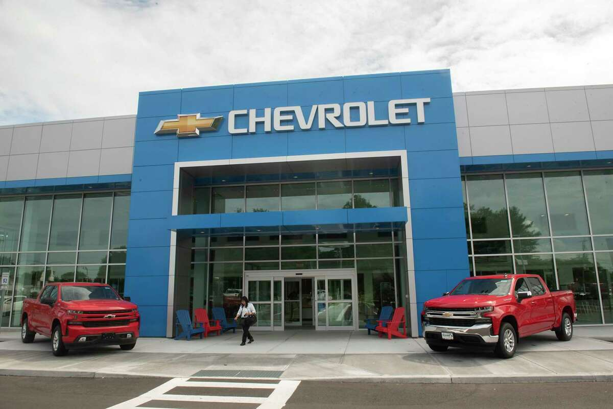 Adirondack chairs are seen outside the front entrance at the new Mohawk Chevrolet on Friday, Aug. 20, 2021 in Ballston Spa, N.Y. The dealership is participating in a local initiative to bring feminine products to those in need.