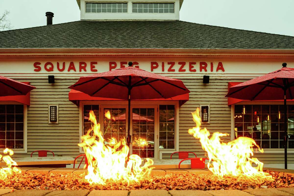 An outdoor fire pit on the patio at Square Peg Pizzeria in Glastonbury