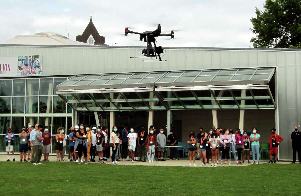A group of 50 incoming high school freshman in Stamford High School, who've started working towards a technology-focused college degree through the Beyond Limits Summer Scholars Program, attend an unmanned aerial vehicle (UAV) flight demonstration by Aquiline Drones at Mill River Park in Stamford, Conn., on Thursday August 19, 2021. This is the fifth year of the week-long summer program, which is organized and managed by Beyond Limits, a division of the Stamford Peace Youth Foundation, Inc.