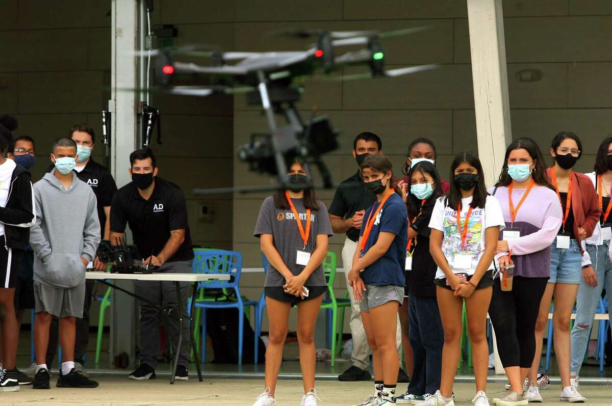 A group of 50 incoming high school freshmen in Stamford High School, who've started working towards a technology-focused college degree through the Beyond Limits Summer Scholars Program, attend an unmanned aerial vehicle (UAV) flight demonstration by Aquiline Drones at Mill River Park in Stamford, Conn., on Thursday August 19, 2021. This is the fifth year of the week-long summer program, which is organized and managed by Beyond Limits, a division of the Stamford Peace Youth Foundation, Inc.