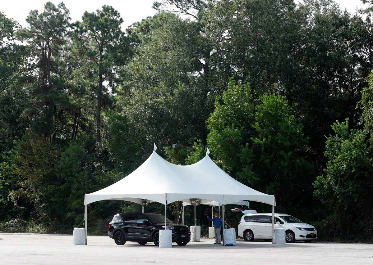 A vehicle is seen at one of Montgomery County's free COVID-19 vaccination sites, Friday, Aug. 20, 2021, in The Woodlands. The site is open through Sunday, Aug. 22nd from 9:00 a.m. to 3:00 p.m. at the corner of Waterway Ave. and Timberloch Pl.