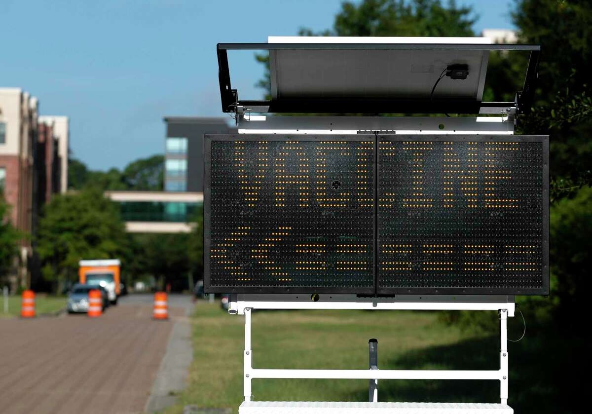 A sign points toward one of Montgomery County's free COVID-19 vaccination sites, Friday, Aug. 20, 2021, in The Woodlands. The site is open through Sunday, Aug. 22nd from 9:00 a.m. to 3:00 p.m. at the corner of Waterway Ave. and Timberloch Pl.