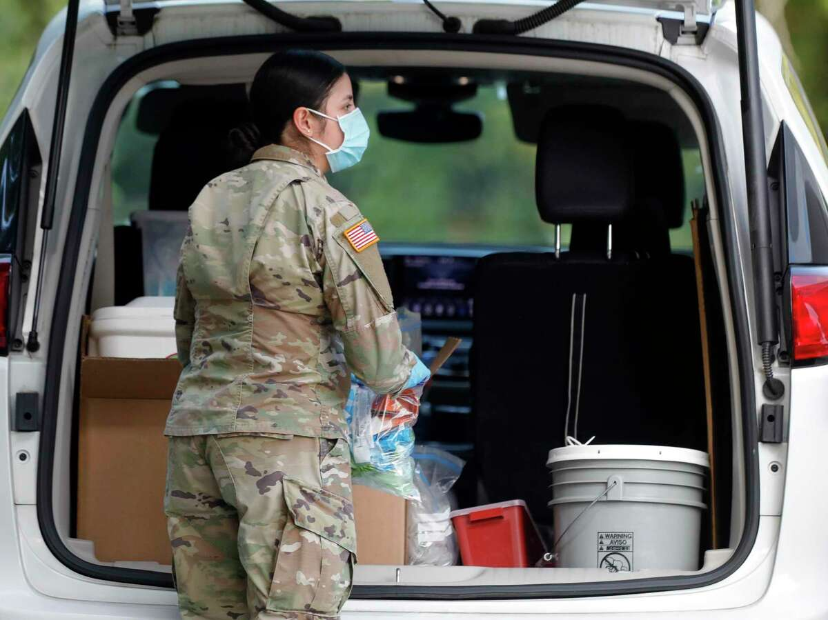 A solider with the Texas National Guard helps work one of Montgomery County's free COVID-19 vaccination sites, Friday, Aug. 20, 2021, in The Woodlands. The site is open through Sunday, Aug. 22nd from 9:00 a.m. to 3:00 p.m. at the corner of Waterway Ave. and Timberloch Pl.