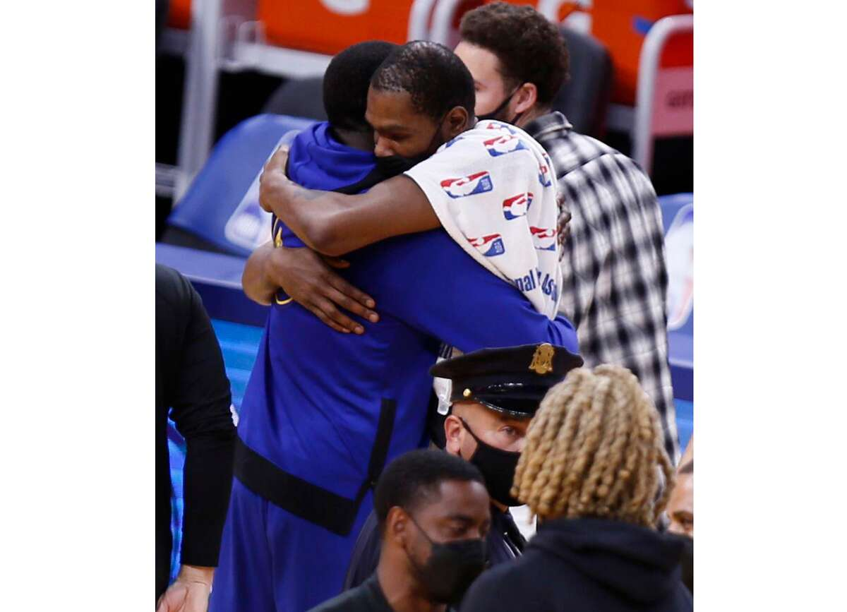 Golden State Warriors forward Draymond Green (23) and Brooklyn Nets forward Kevin Durant (7) embrace after the NBA game at Chase Center, Saturday, Feb. 13, 2021, in San Francisco, Calif. The Nets won 134-117.