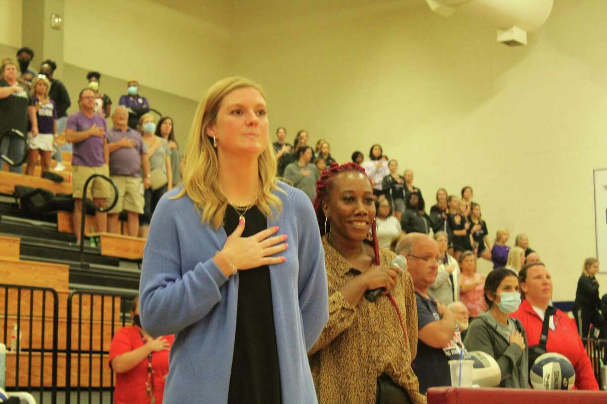 Atascocita volleyball coach Madeline Odom (left) is in her first season coaching with the Lady Eagles.