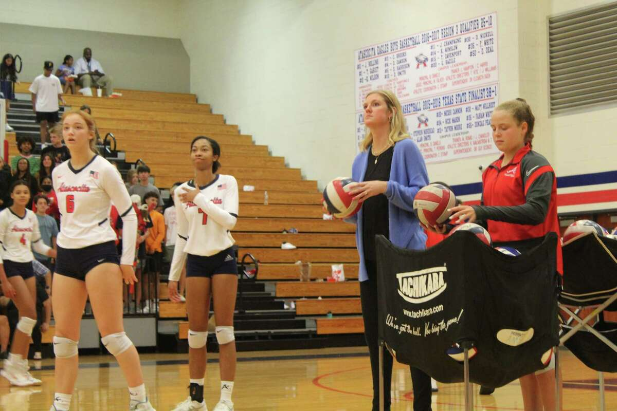 Atascocita volleyball coach Madeline Odom (middle) looks on as her Lady Eagles warm up. Odom is in her first season coaching the Lady Eagles.