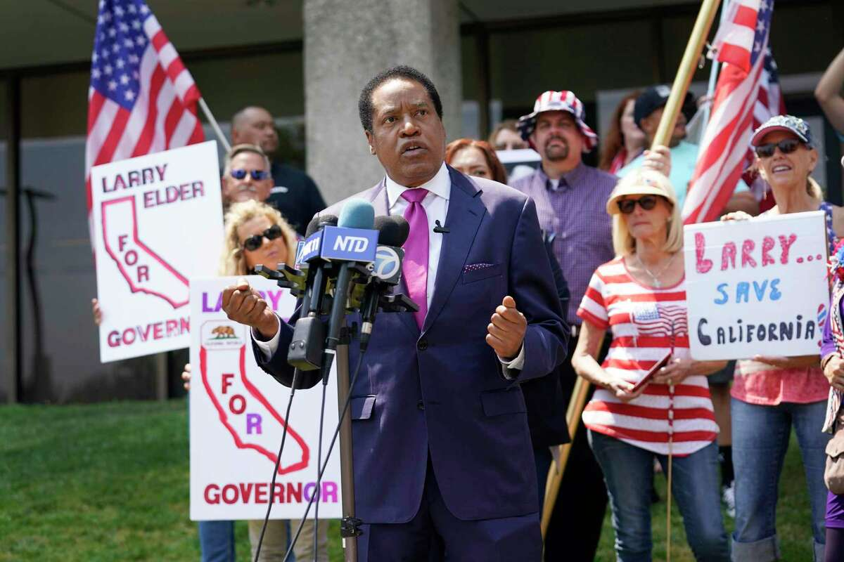 Radio host Larry Elder, seeking to replace Gov. Gavin Newsom in the recall election, speaks to supporters July 13 during a campaign stop in Norwalk (Los Angeles County).