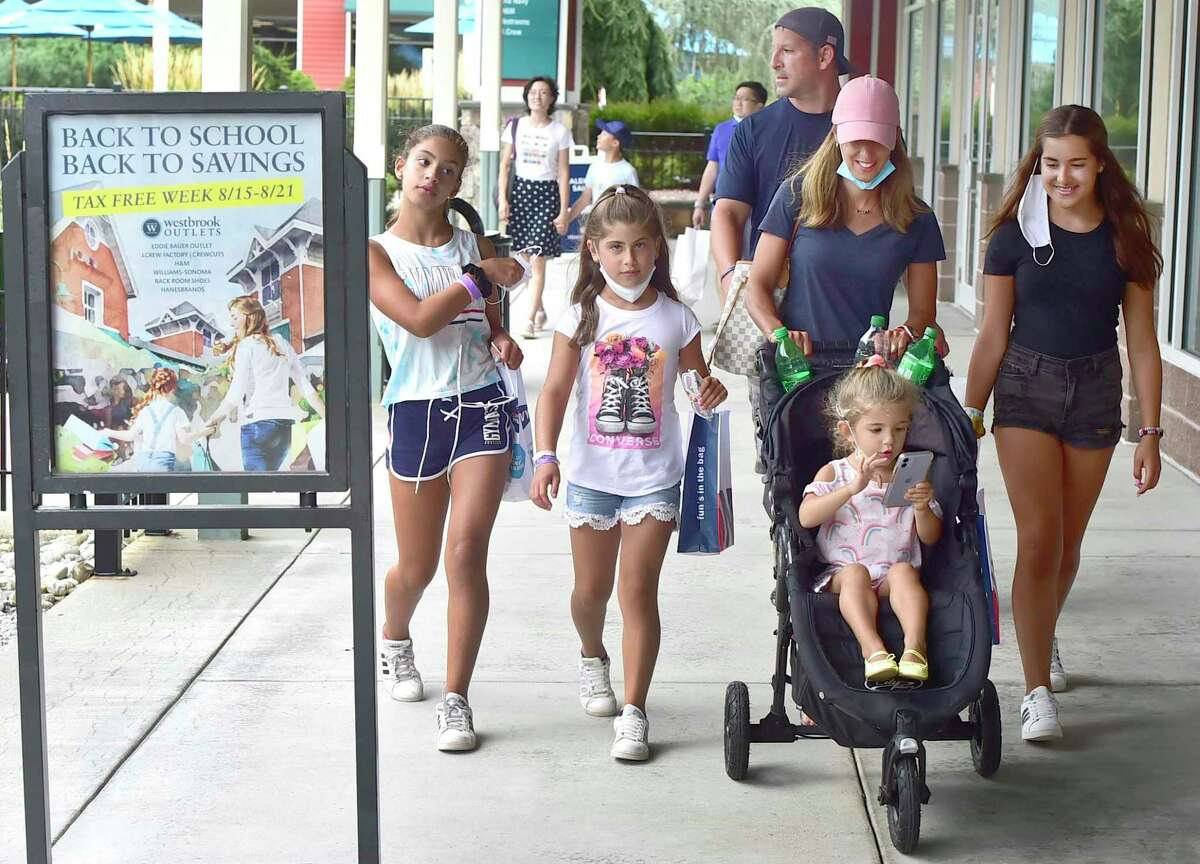 Marc and Karen Mirabella of White Plains, N.Y., on vacation in Connecticut, take advantage of the shopping at the Westbrook Outlets Aug. 19, 2021. The children, from left: Emily, 11, Alexa, 9, Nadia, 3, and Julia, 4.