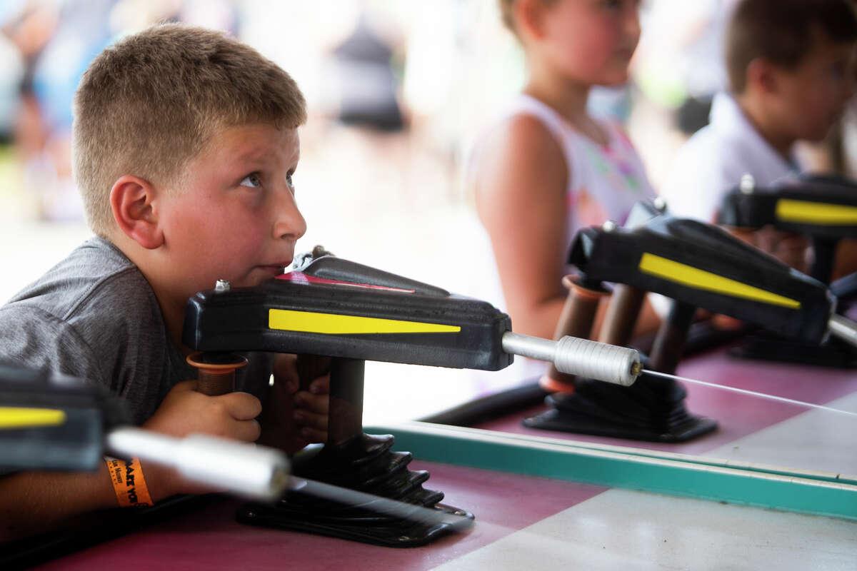 Fairgoers enjoy rides and games at the Midland County Fair carnival Friday, Aug. 20, 2021. (Katy Kildee/kkildee@mdn.net)