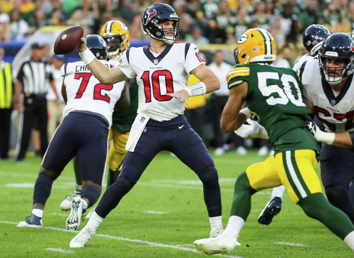 Houston Texans quarterback Davis Mills (10) drops back to pass against the Green Bay Packers during the second quarter of an NFL pre-season football game Saturday, Aug. 14, 2021, in Green Bay, Wis.
