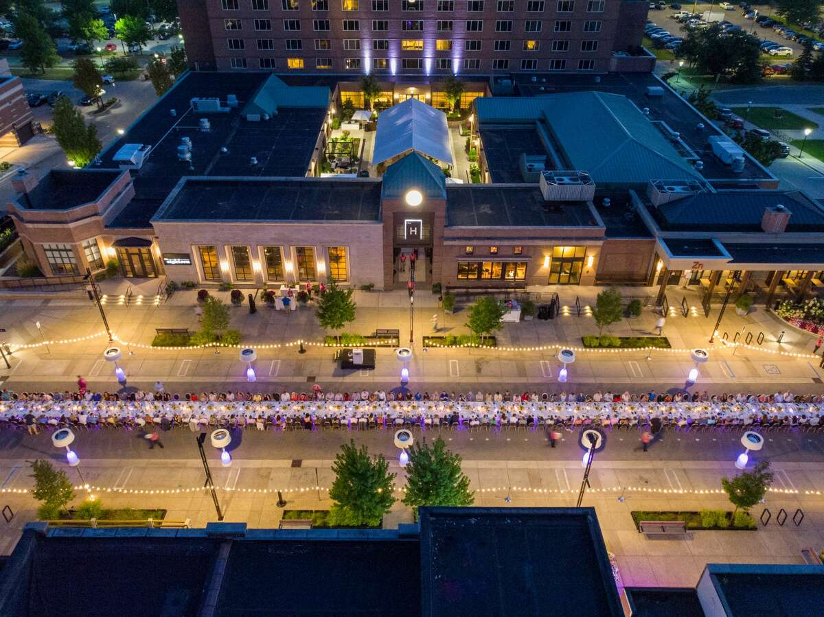 About 200 guests and 120 volunteers took part in Dinner on Main - Gather for Good on Thursday night, dining on one long table over almost an entire block of Main Street in front of the H Hotel. The event raised $81,000 for Cancer Services. (Ben Tierney and Charles Bonham)