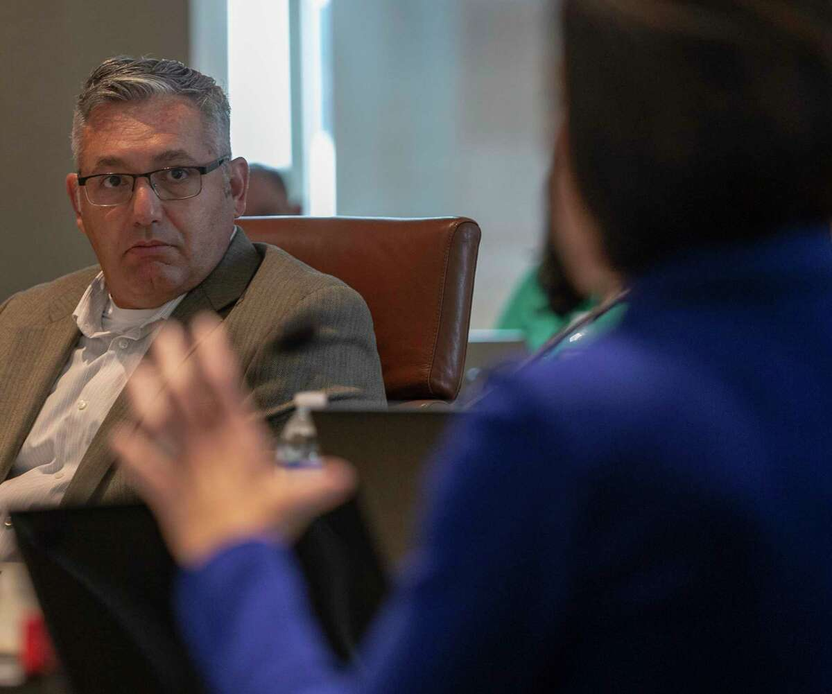 Christopher Lutton, chair of the San Antonio Police Officer Association's contract negotiation committee, listens July 8 during a round of contract negotiations.