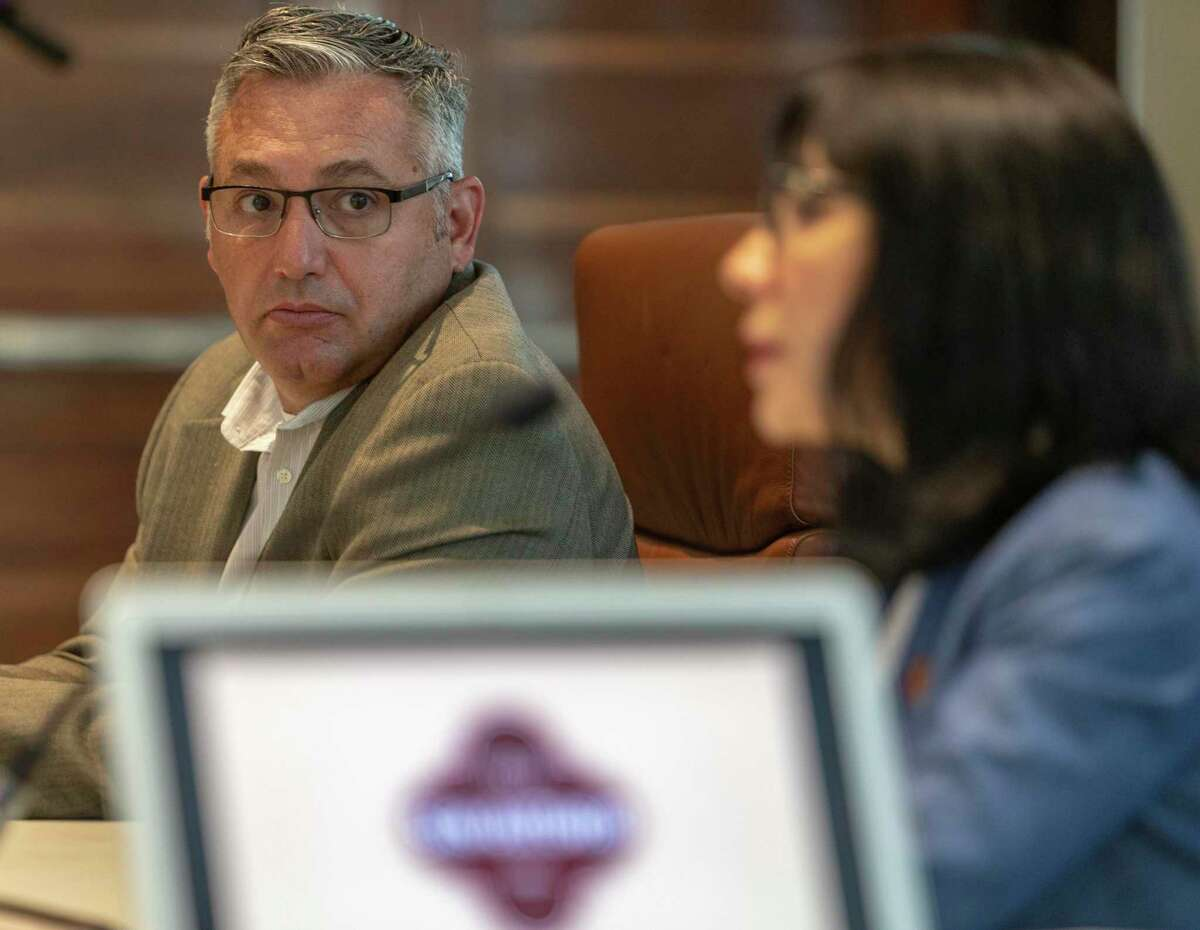 Christopher Lutton, chair of the San Antonio Police Officer Association's contract negotiation committee, listens July 8 to María Villagómez, deputy city manager and head of the city's negotiating team, during a round of negotiations.