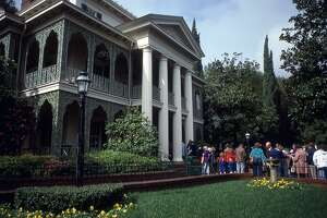 View of park goers waiting in line to enter the Haunted Mansion attraction at Disneyland, Anaheim, California, February 1980. (Photo by Walter Leporati/Getty Images)