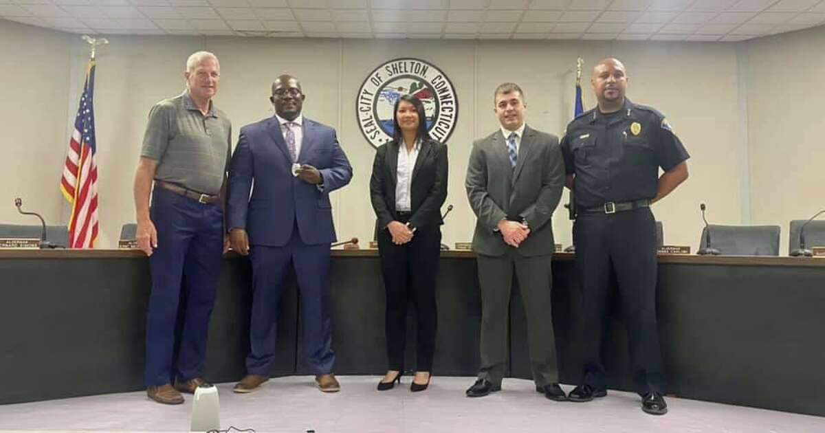 Officers Kamar Gidden (second from left), Cyndy Trinh and Robert Franco flanked by police Chief Shawn Sequeira, were sworn in by Mayor Mark Lauretti (left) at City Hall.